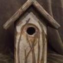 Carved_birdhouse_front_thumb128